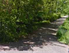 Remains of railroad bed via Google Maps.
